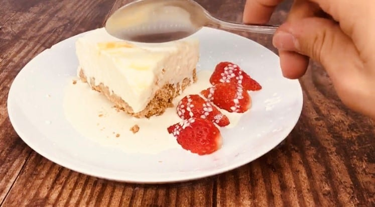 eating no bake lemon cheesecake with strawberries