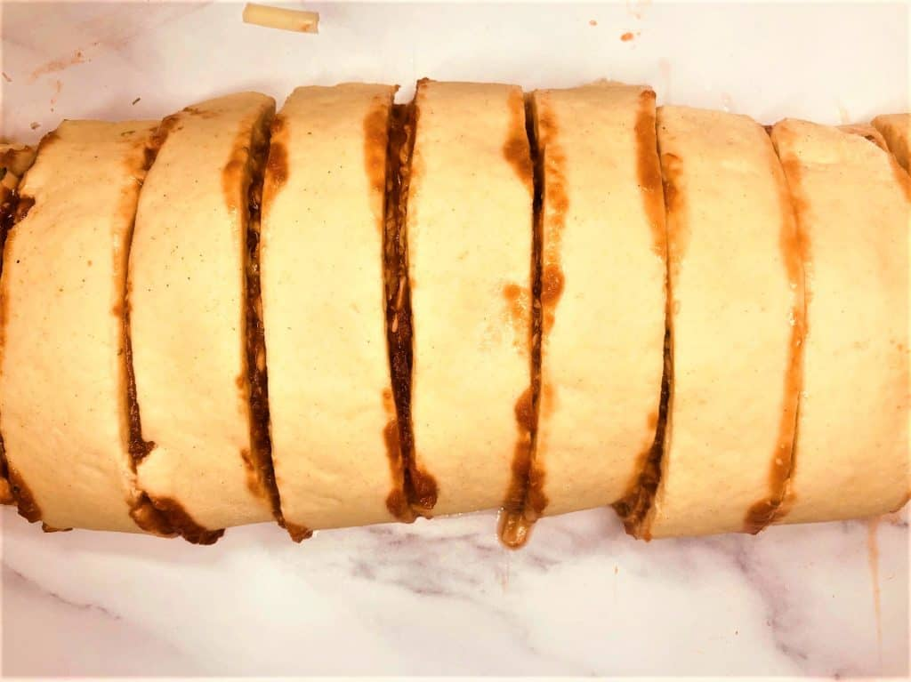 rolled up pizza roll and sliced