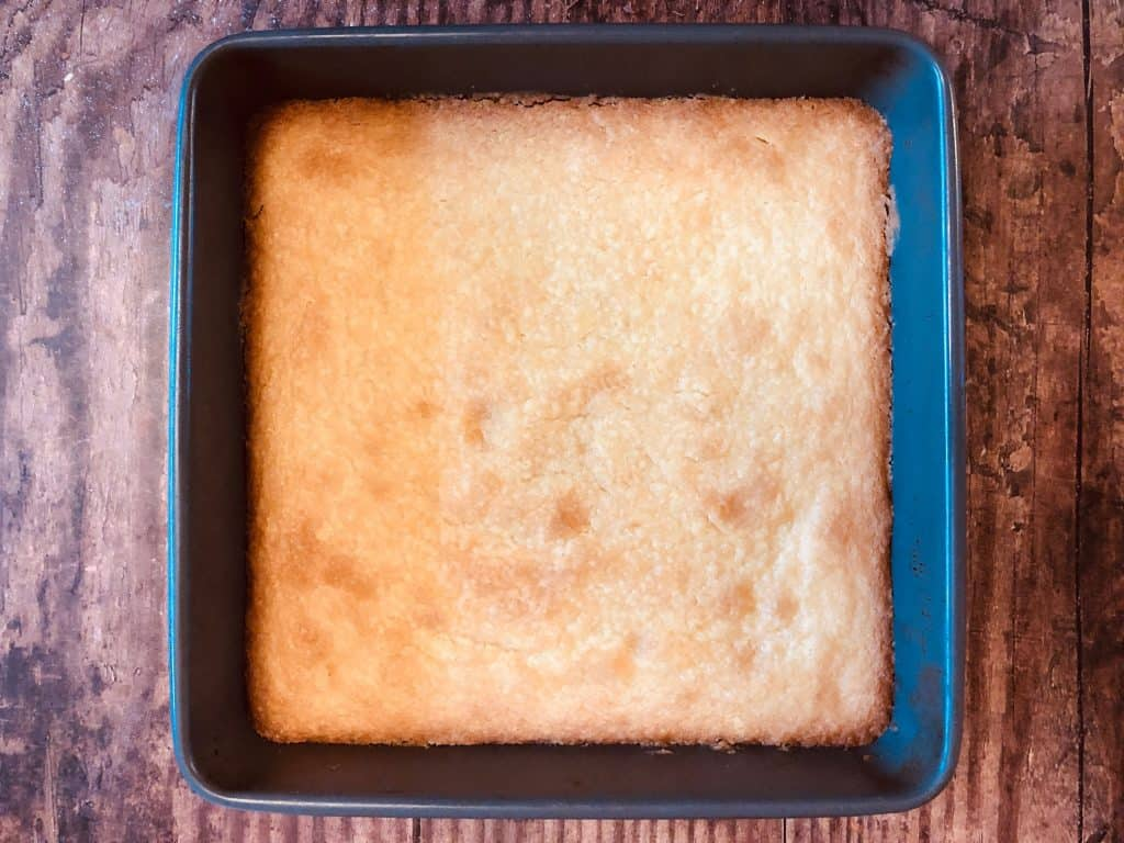 shortbread in baking tin straight out of the oven