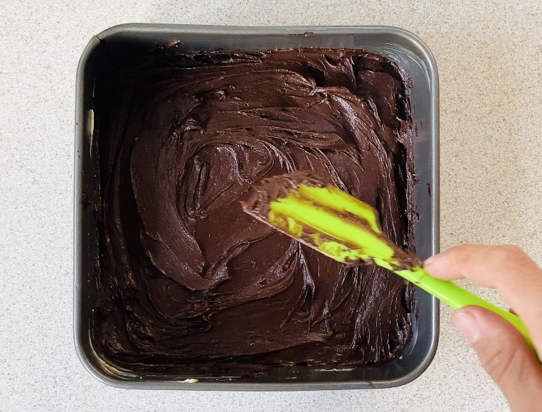 brownie batter in a baking tin