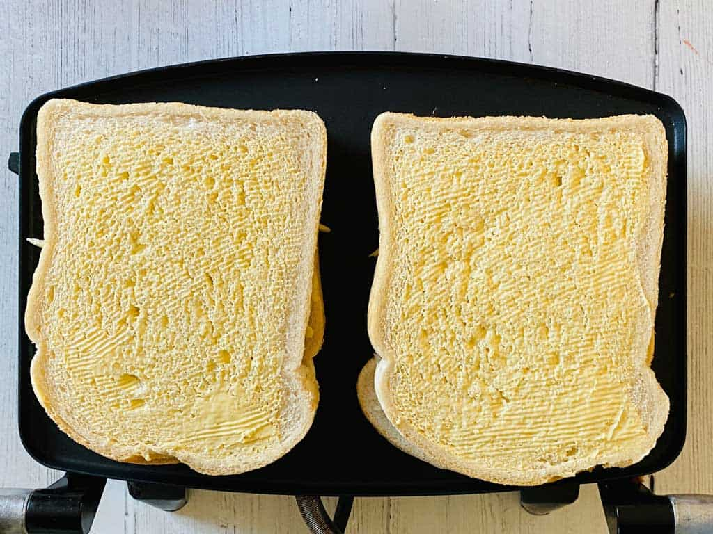 buttered bread on sandwich toaster