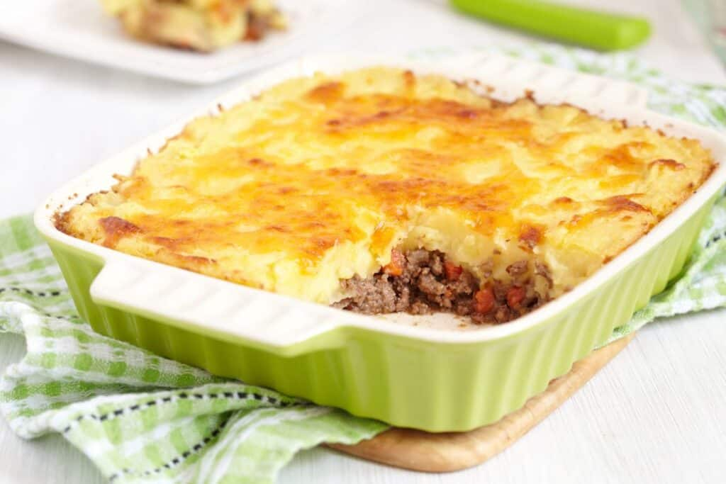 cottage pie in a green oven dish