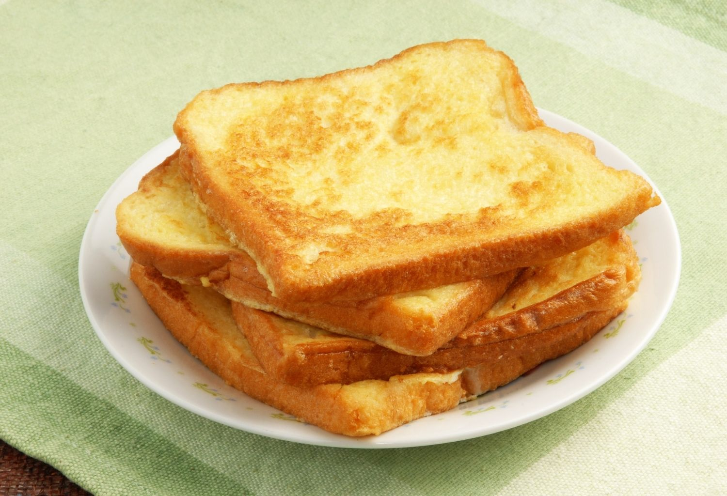 eggy bread slices on a plate