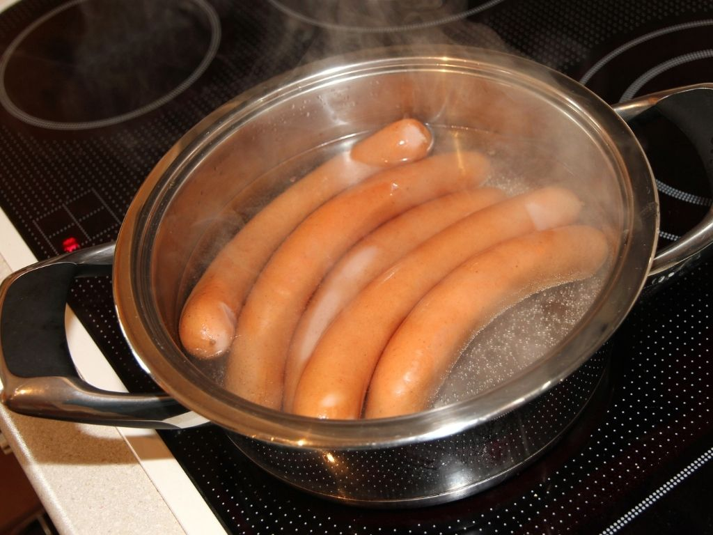 boiling sausages in a saucepan