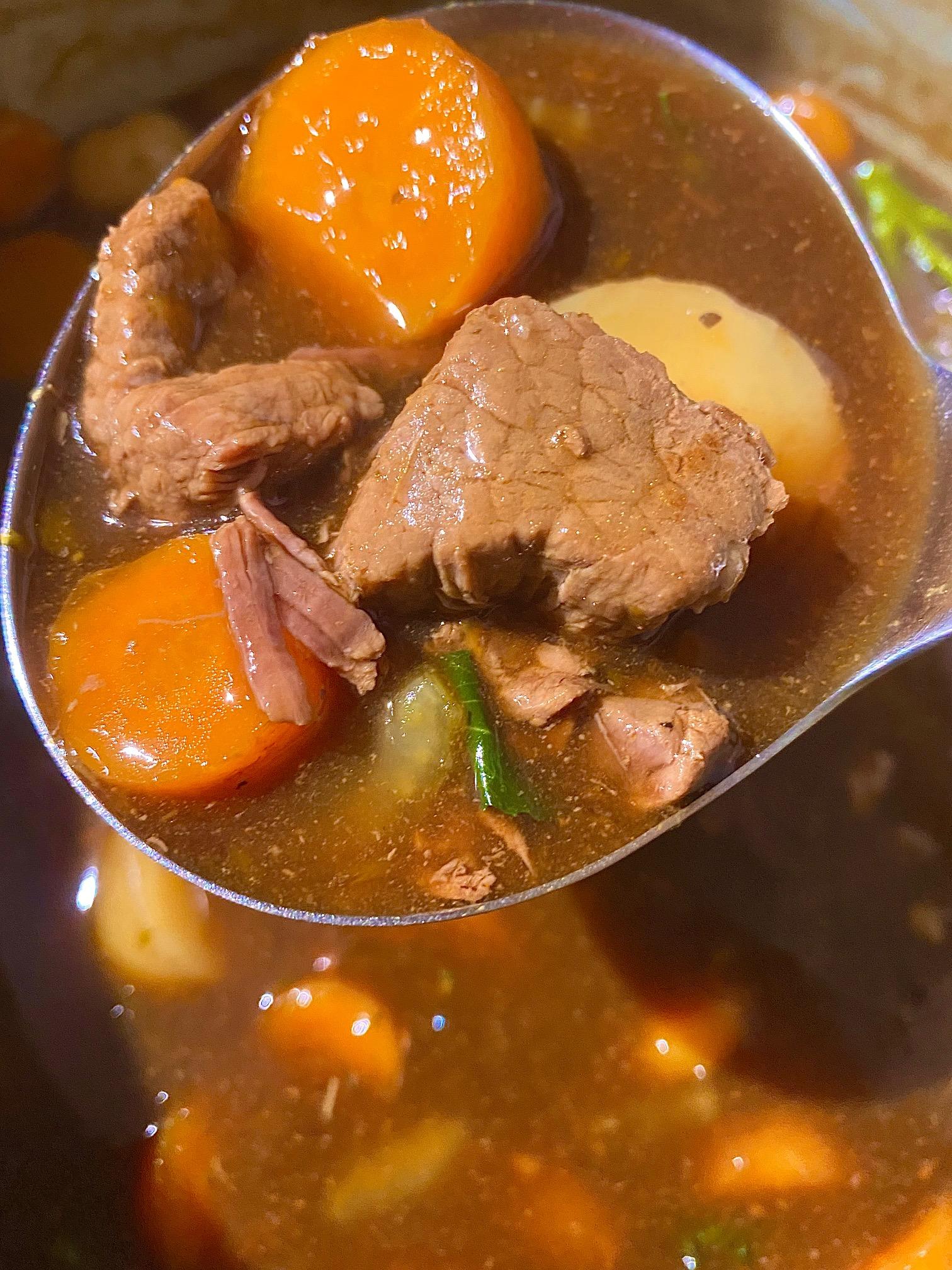Ninja Foodi beef stew with serving spoon