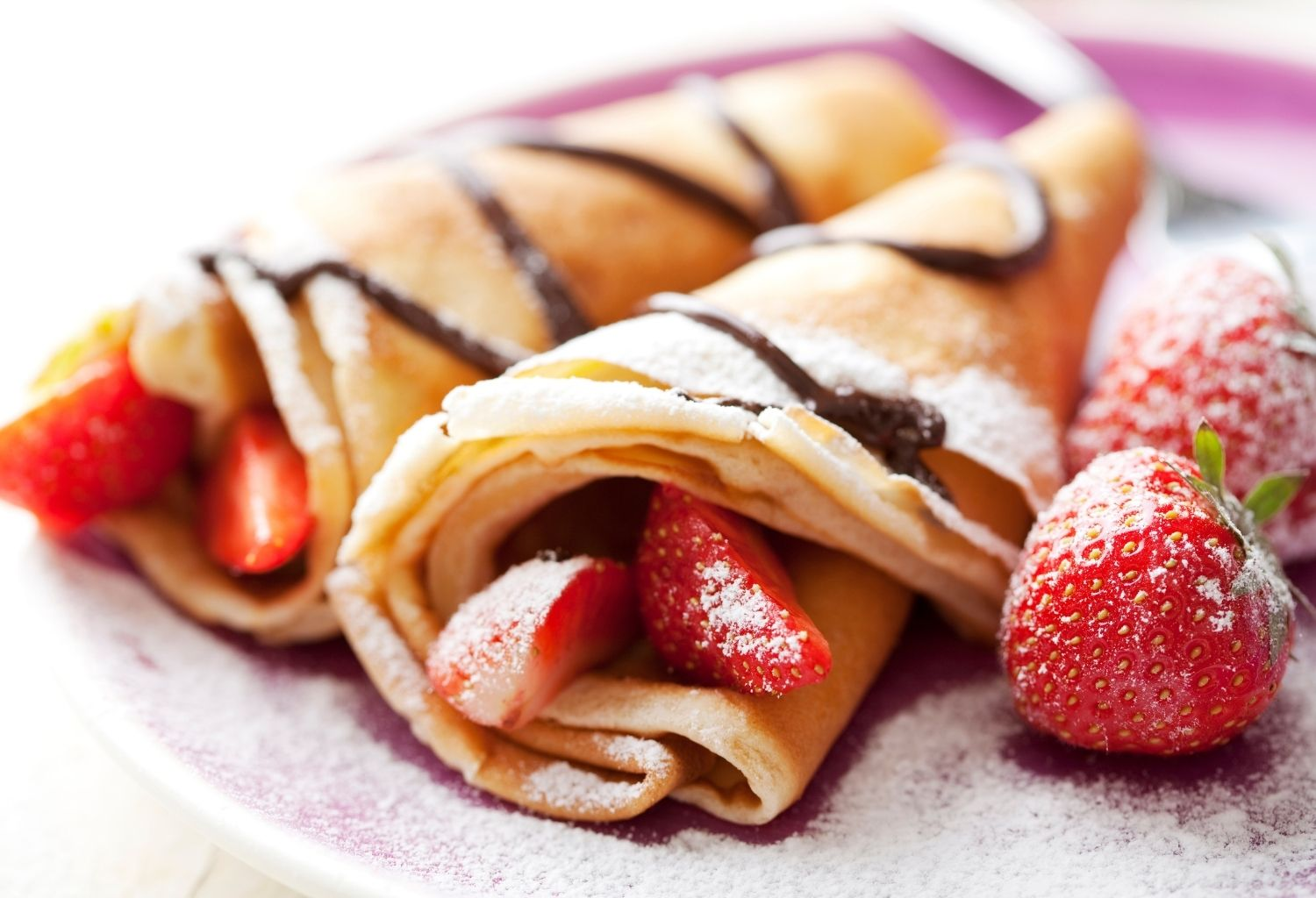 pancakes with strawberry and chocolate toppings