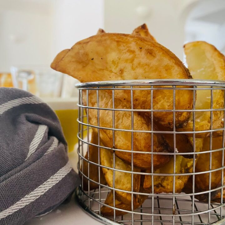 air fryer potato wedges in basket