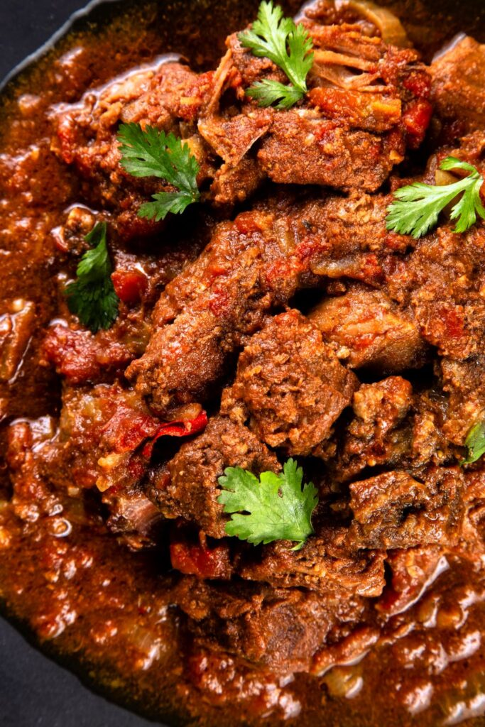 slow cooker beef curry with coriander up close