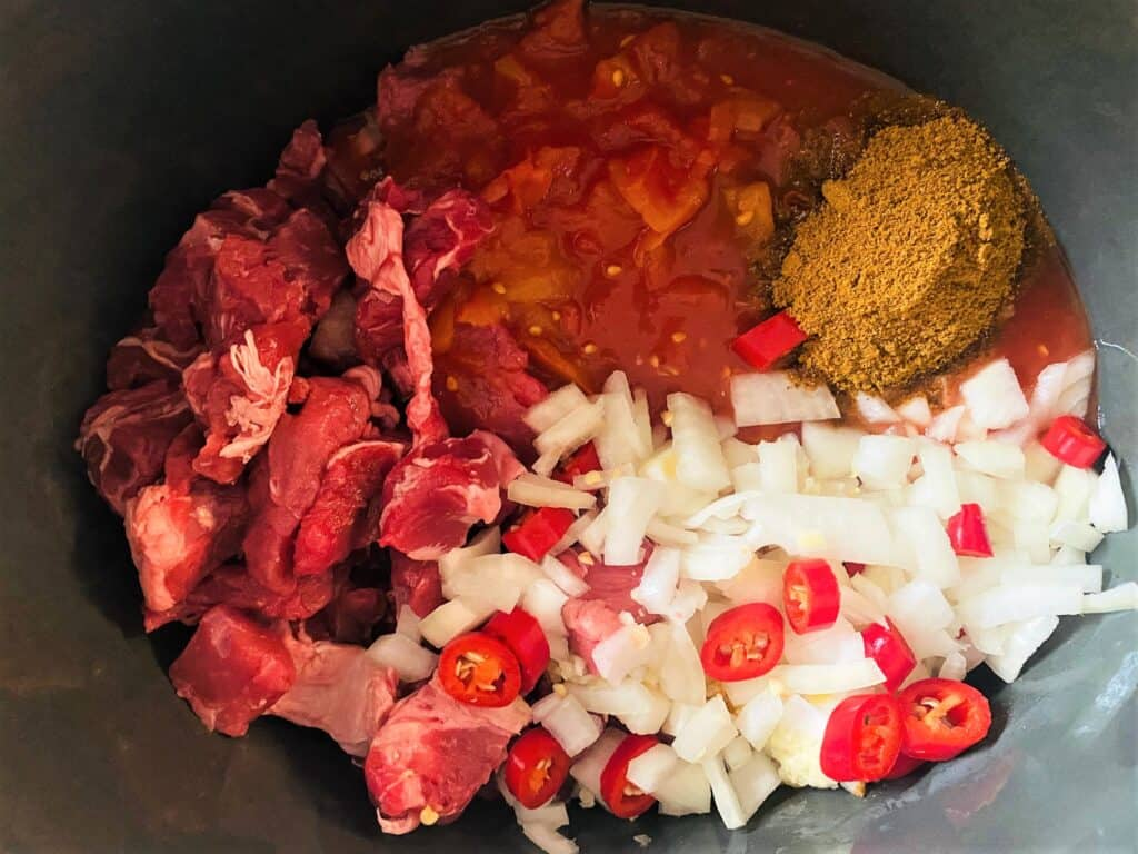 beef curry ingredients in slow cooker