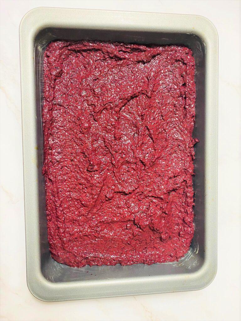 beetroot brownie batter in baking tine