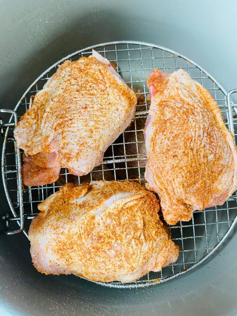 chicken thighs in air fryer on rack