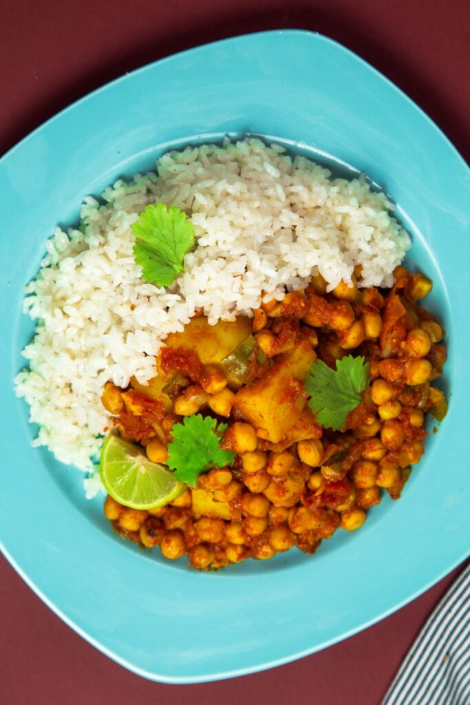 slow cooker chickpea curry with rice on plate