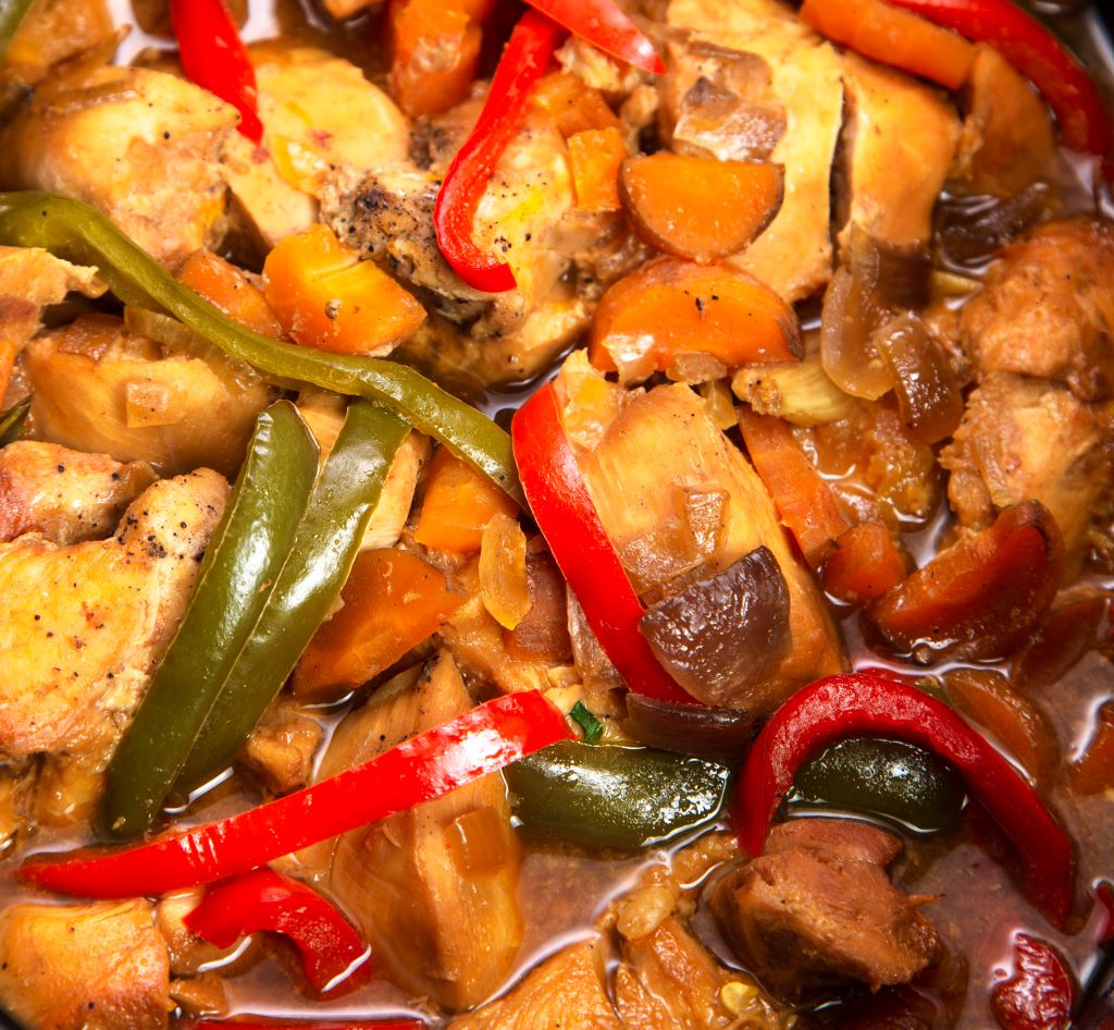 adding peppers to sweet and sour chicken in slow cooker