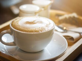 cappuccino in cup and saucer made without an espresso machine