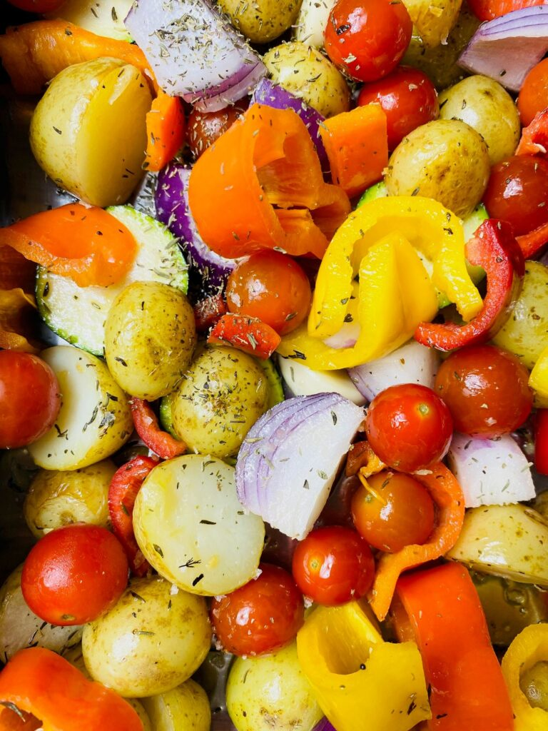 chopped vegetables ready to be put in the oven for a mediterranean vegetable roast