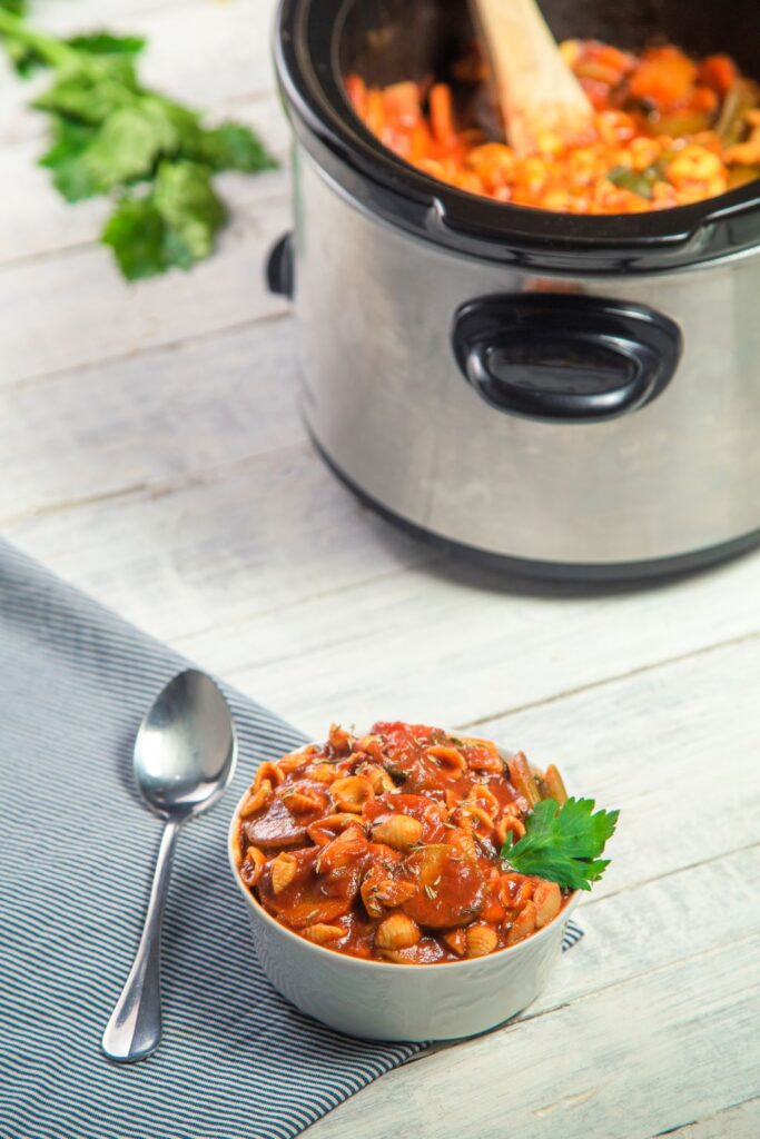minestrone soup next to slow cooker