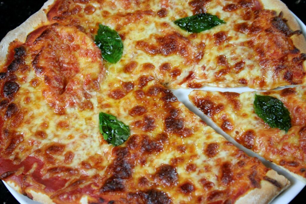 pizza with basil leaves