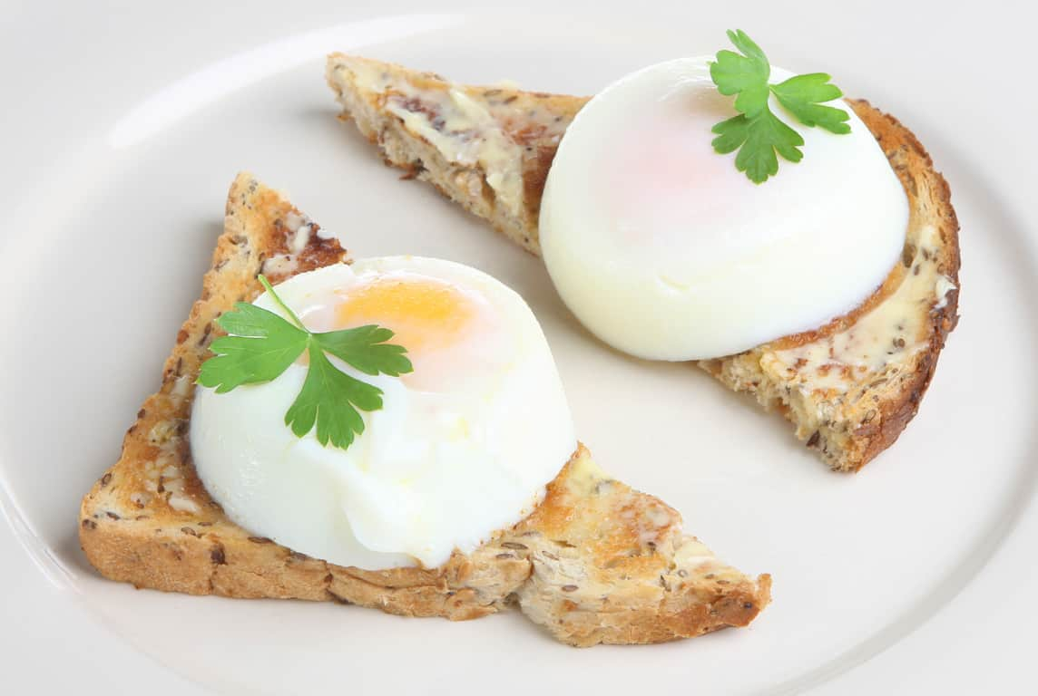 2 poached eggs on buttered toast