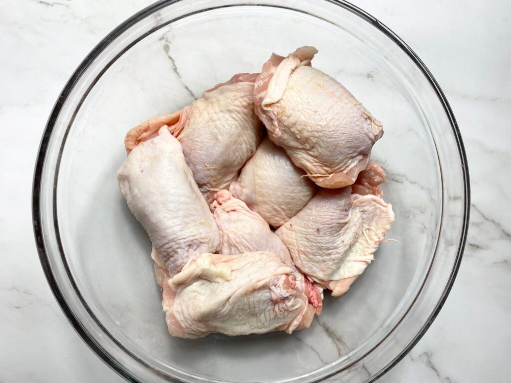 raw chicken thighs in a bowl