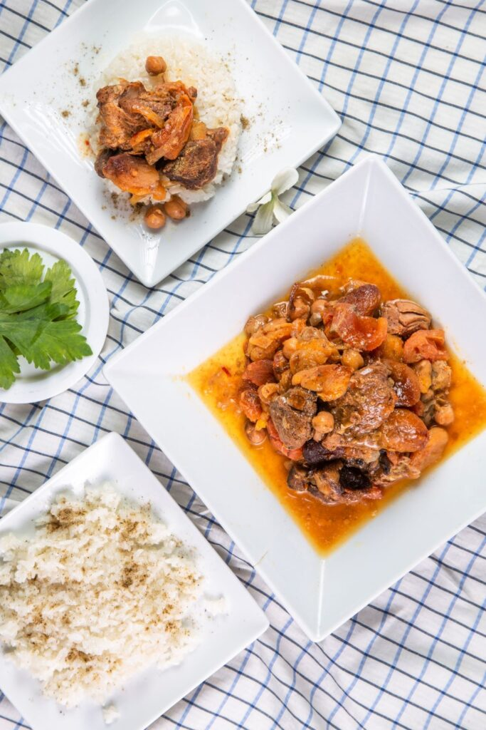 slow cooker lamb tagine and rice served on plates