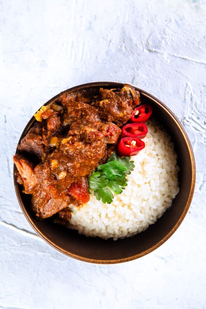 slow cooker beef curry served in a bowl