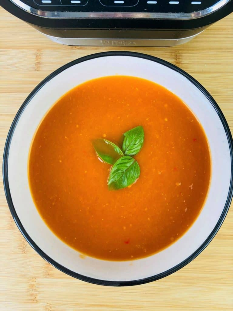 spicy tomato soup next to Ninja Soup Maker