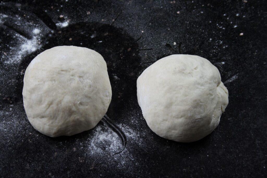 pizza dough split into two