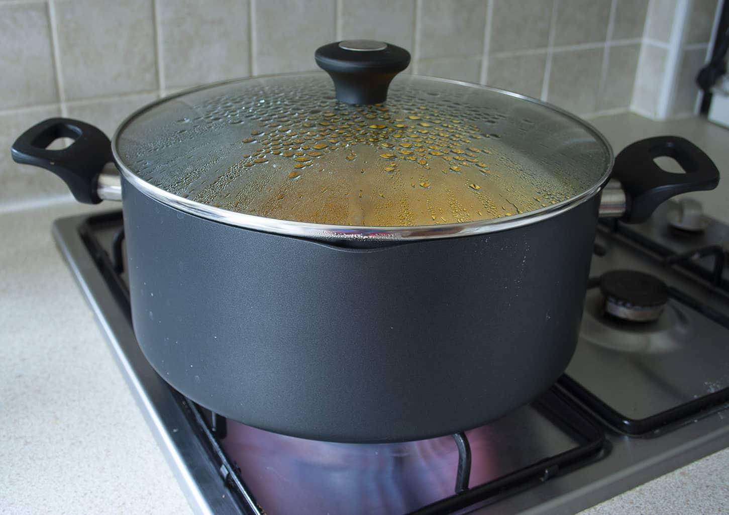 steaming the pumpkin in a saucepan