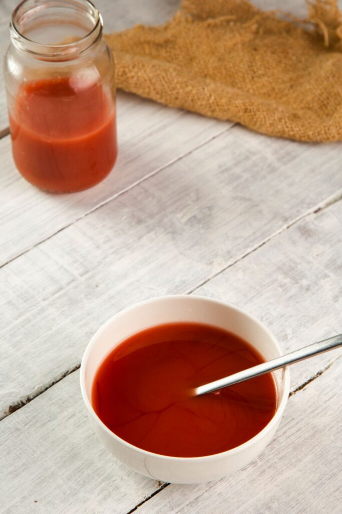 sweet and sour sauce in jar and bowl